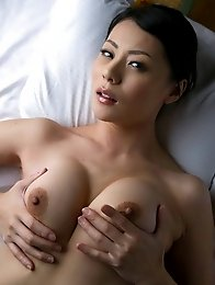 Mature and lovely Japanese av idol Nana Aida lies outdoor naked for you
